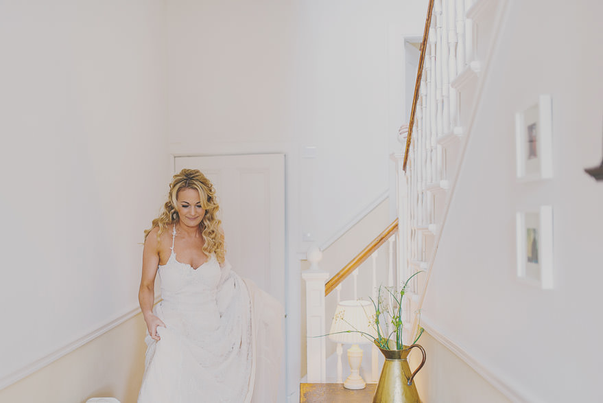 bride walking downstairs at dell of abernethy