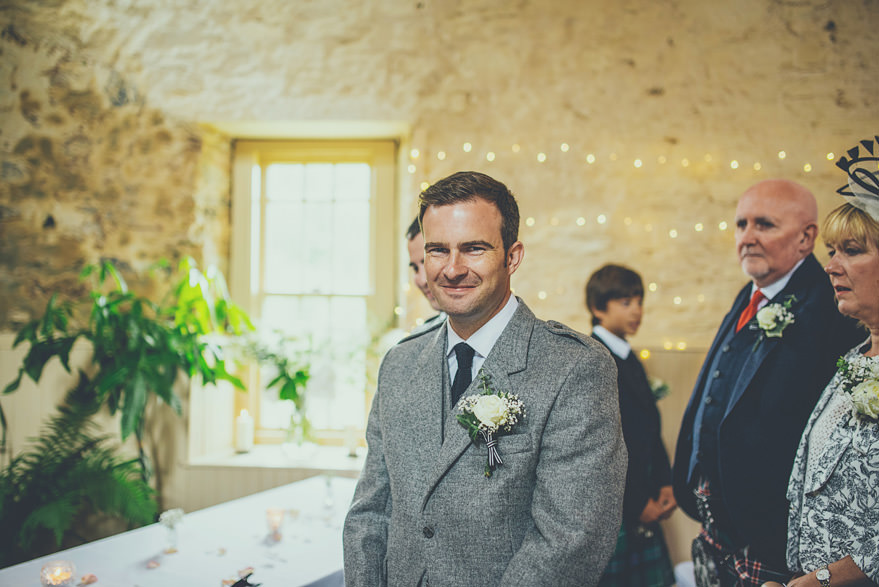 groom waiting for the bride inside lochnell castle
