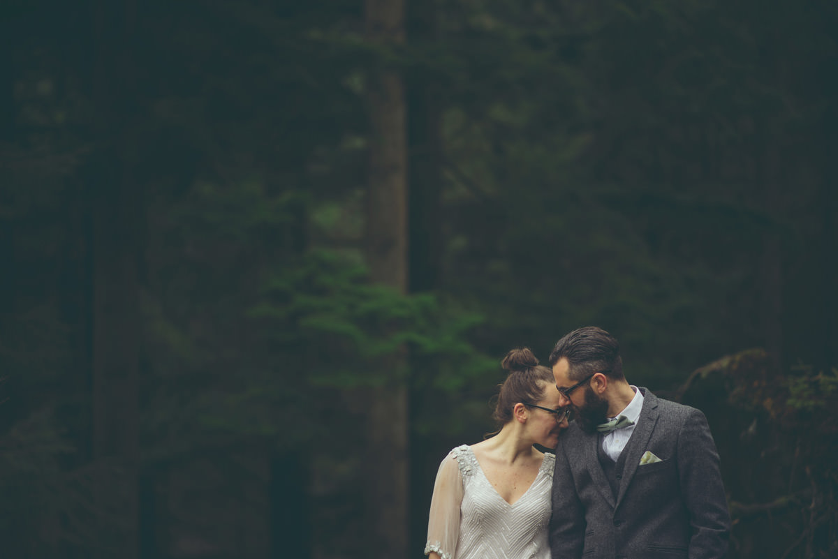 bride and groom in scottish countyside