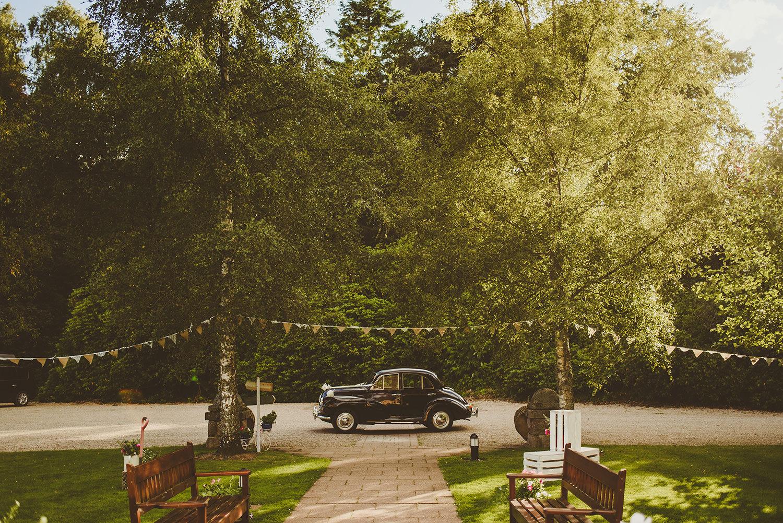 wedding car parked outside glen tanar