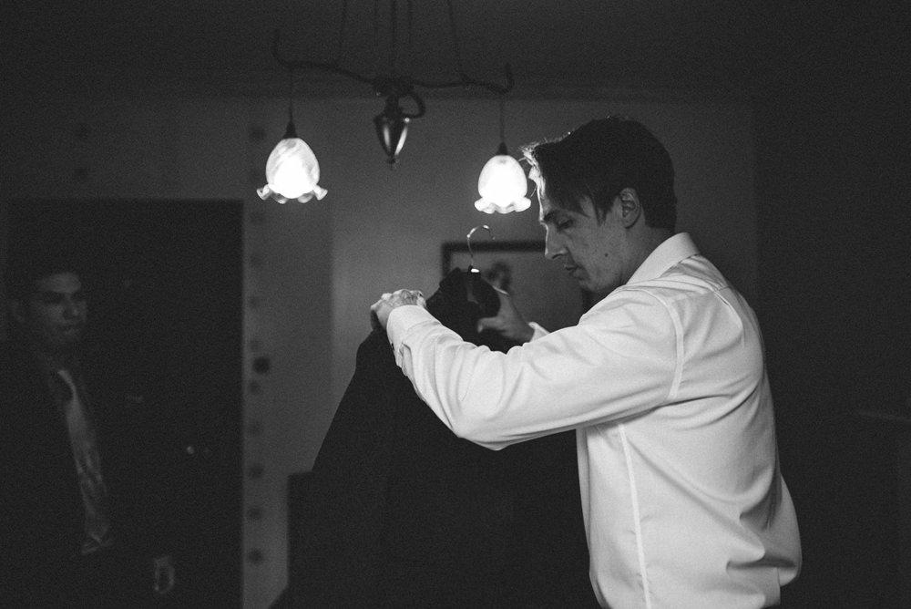 groom getting ready at dunskey castle