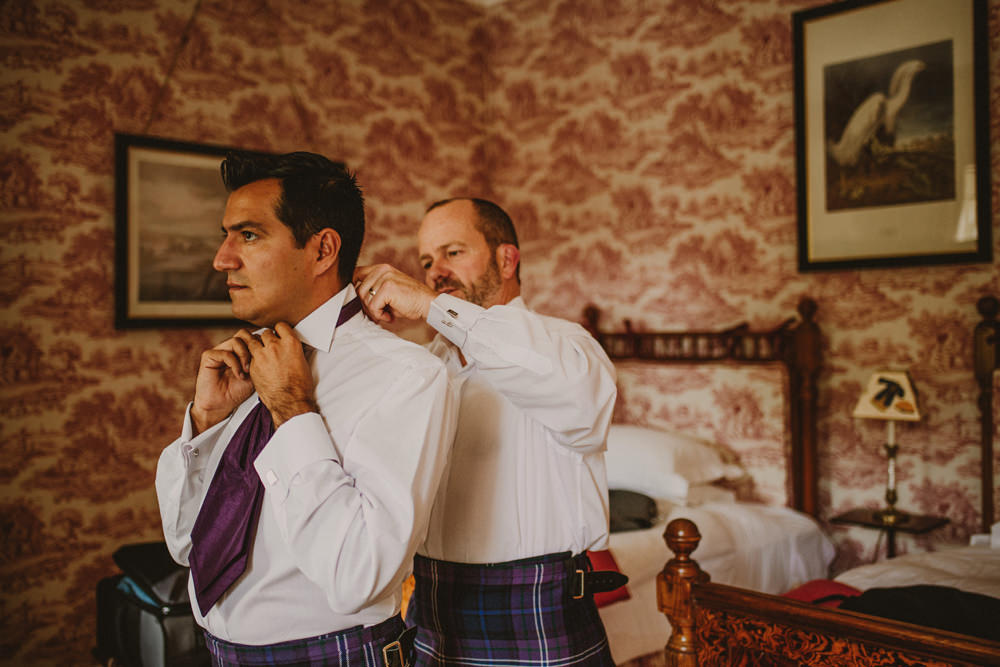 groom getting ready at dundas castle